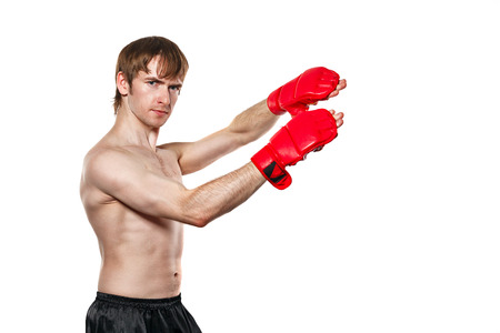 enforcer: Male fighter kung fu kick to the head blocks. Isolated on white background. The concept of martial arts.