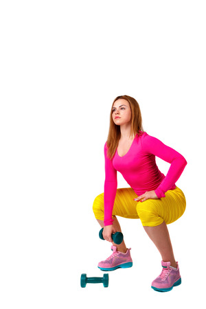 Young athlete squats with dumbbells, isolated on white background. Healthy lifestyle concept. Stock Photo