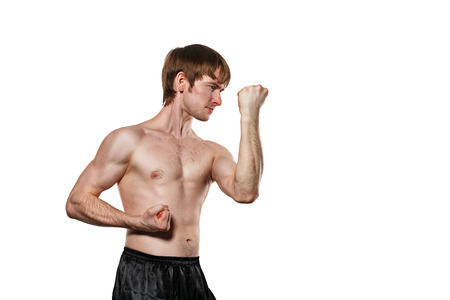 enforcer: The man trains kata kung fu block the blow. Isolated on white background. The concept of masculine strength and a healthy lifestyle.