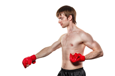 enforcer: Male fighter kung fu strike directly down. Isolated on white background. The concept of martial arts. Stock Photo