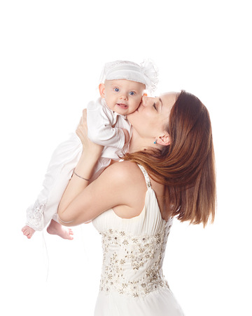 firstborn: Happy mother kissing her firstborn. Isolated on white background. The concept of happiness is having children. Stock Photo
