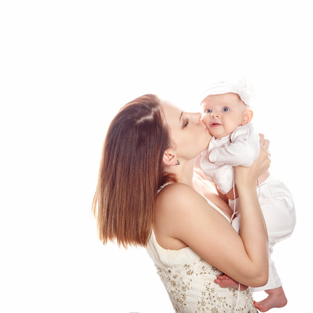 firstborn: Young mother kissing firstborn. The concept of happiness in the family.