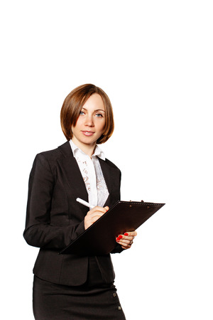 checklist: Young successful business woman writes requests of customers in checklist. The concept of B2B marketing and sales.