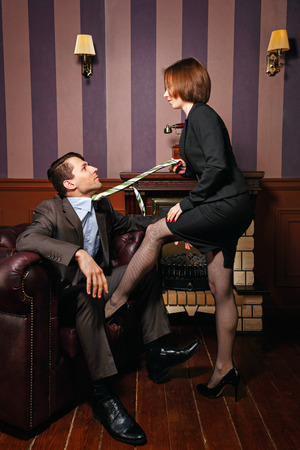 moneymaker: Business woman puts pressure on a partner in the transaction. Vintage interior. The concept of running a successful business. Dishonest business. Stock Photo