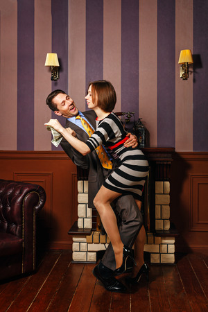 moneymaker: Business partners share the money. She takes money from her business partner. Vintage interior. The concept of running a successful business. Stock Photo