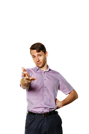 Friendly successful businessman in his shirt held out his hand forward. The concept of a friendly business. Stock Photo