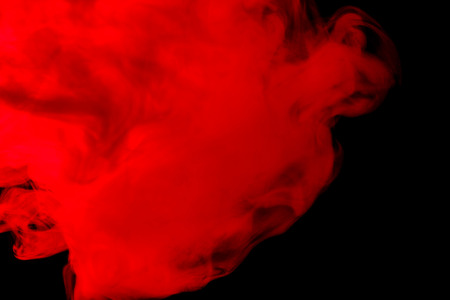 black smoke: Abstract red-orange hookah smoke on a black background. Photographed using a gel filter. Texture. Design element.