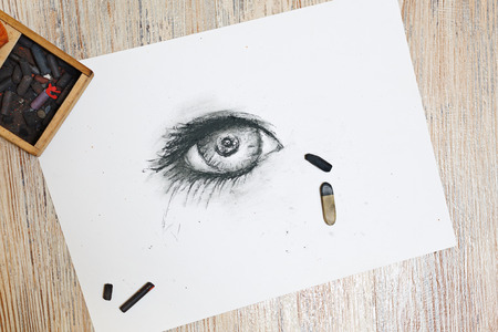 fine detail: The human eye is drawn in charcoal on paper. The concept of creativity.