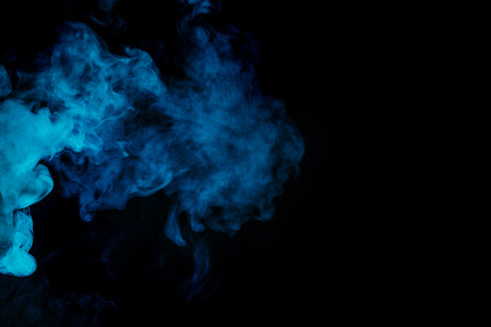 Abstract blue hookah smoke on a black background. Photographed using a gel filter. The concept of of unhealthy. Stock Photo