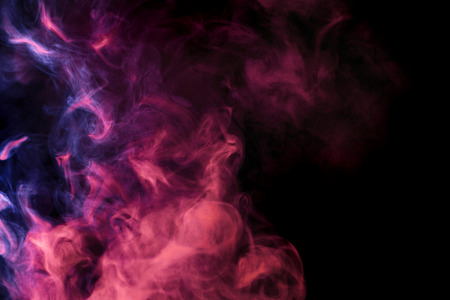 Abstract colored smoke hookah on a black background. Photographed using a gel filter. Texture. Design element. Stock Photo