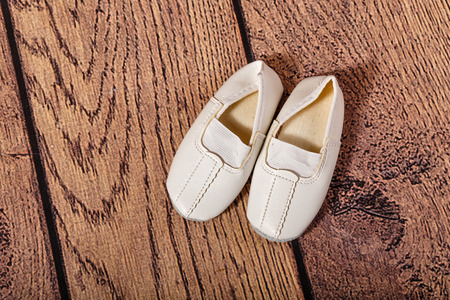 choreographic: Children Gym shoes on a wooden floor. The concept of classical ballet and modern dance. Stock Photo