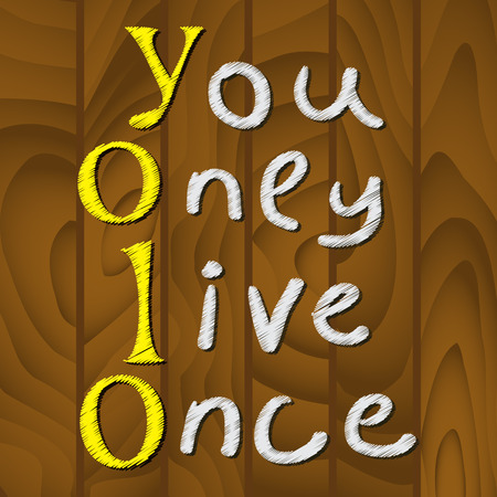 once: Yolo. You only live once. On the abstract wooden background. The concept of freedom and progress.
