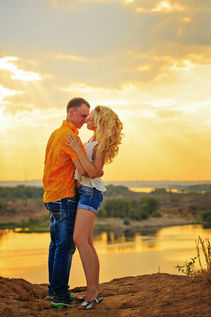 passionate embrace: Loving couple passionate embrace. Sunset. Summer day. The concept of a romantic relationship.