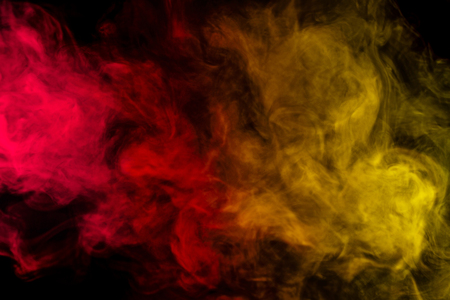 sustancias toxicas: Abstract art. Colorful red and yellow smoke hookah on a black background. Background for Halloween. Texture fog. Design element. The concept of toxic substances.