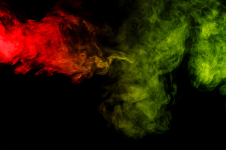 sustancias toxicas: Abstract art. Colorful red and green smoke hookah on a black background. Background for Halloween. Texture fog. Design element. The concept of toxic substances.