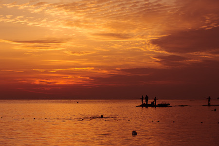 big game fishing: Big Game Fishing at sundown. Landscape of the ocean and sunset in the clouds. Unrecognizable silhouettes of people. The concept of rest.