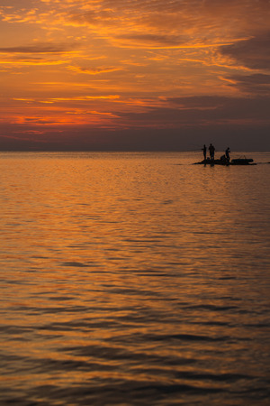 big game fishing: Big Game Fishing at sunset. Landscape of the ocean and sunset in the clouds. Unrecognizable silhouettes of people. The concept of rest. Stock Photo