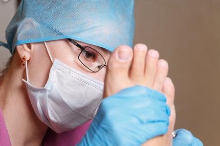 chiropodist: Master chiropody removes calluses and corns. Hardware manicure. Concept body care.