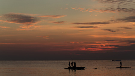 game fishing: Big Game Fishing sunset. Landscape of the ocean and sunset in the clouds. Unrecognizable people silhouettes. The concept of fishing.