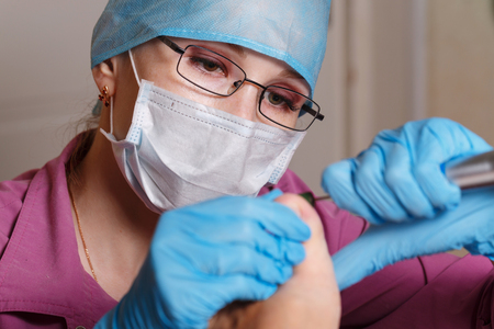 Master chiropody removes calluses and corns. Hardware manicure. Concept body care.