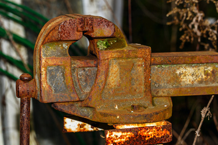 vise: Old rusty blacksmith vise. The concept of the manual labor. Jack of all trades. The old production.