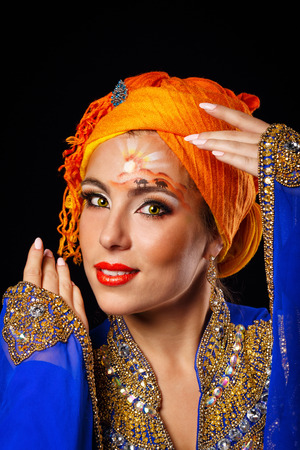 arab model: Portrait of oriental beauty with face art and national costumes. The concept of the eastern fashion.