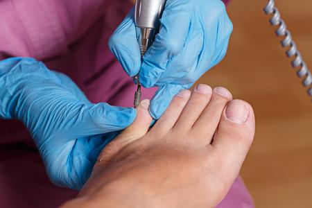 chiropody: Master chiropody shapes the nails and cuticles close up.