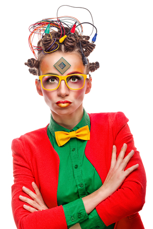Girl geek in glasses. Crazy programmer. Creative make-up, hairstyle with wires and processor.
