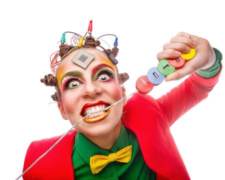 Girl geek biting a wire. Crazy programmer.