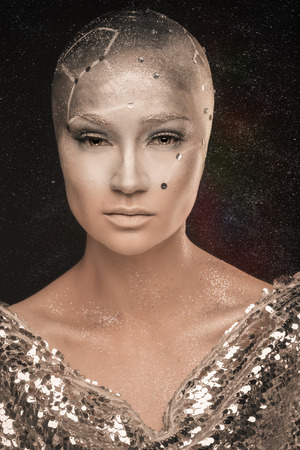 psychic reading: Girl with creative makeup. Girl astronomer. Astrologer. Cosmological universe. Predictions. Prophet . Looking into the future. Cold light of the stars. Without hair girl. Mixed light.