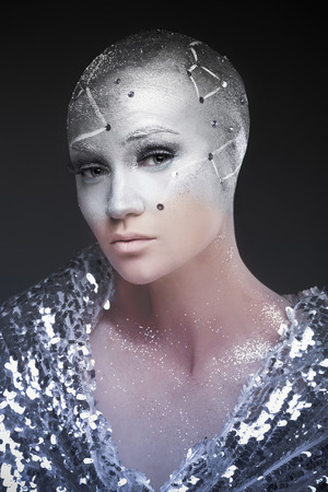 astrologist: Girl with creative makeup. Girl astronomer. Astrologer. The cosmological universe. Predictions. The cold light of the stars. Stock Photo
