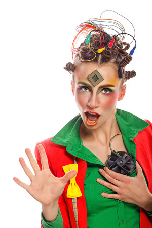 dweeb: Girl geek holding cooler in place of the heart. Crazy programmer. Creative make-up, hairstyle with wires and processor. Stock Photo