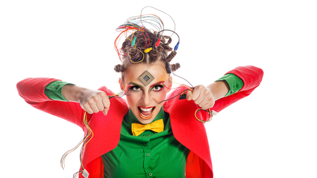Girl geek tearing wire. Crazy programmer. Creative make-up, hairstyle with wires and processor.