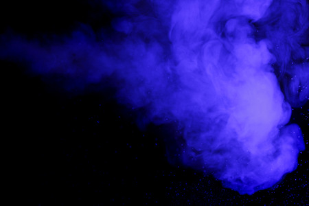 concept magical universe: Abstract art. Blue hookah smoke and water drops on a black background. Inhalation. The steam generator. The concept of poison gas. Universe.