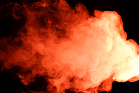 Abstract art. Red smoke hookah on a black background. Inhalation. The steam generator. The concept of poison gas. Gas.