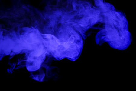 Abstract art. Blue smoke hookah on a black background. Inhalation. The steam generator. The concept of poison gas. Standard-Bild