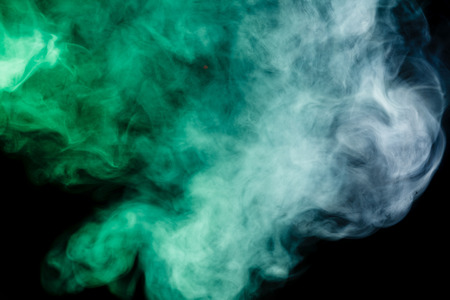 black smoke: Abstract art. Blue-green smoke hookah on a black background.