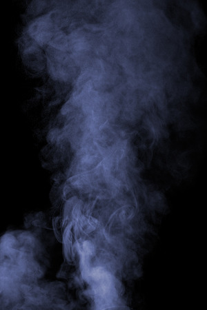 humidifier: Abstract blue water vapor on a black background. Texture. Design elements. Abstract art. Steam the humidifier. Macro shot.