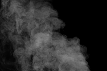 humidifier: Abstract white water vapor on a black background. Texture. Design elements. Abstract art. Steam the humidifier. Macro shot. Stock Photo