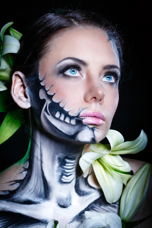 Young attractive girl with creative make-up for Halloween. Close-up portrait. Stock Photo
