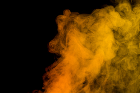 humidifier: Abstract red yellow water vapor on a black background. Texture. Design elements. Abstract art. Steam the humidifier. Macro shot.