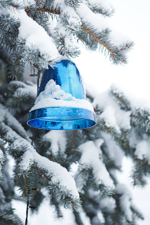 snowcovered: Bell as the Christmas decorations on the Christmas tree in the city park in the winter. Christmas mood. Stock Photo