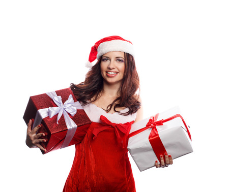 Young attractive girl in a suit of Santa Claus holds two Christmas gift. She is happy. Sale. Christmas mood. Stock Photo