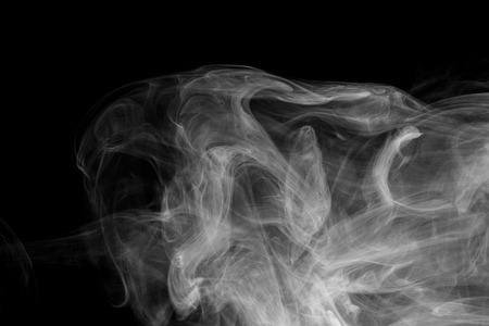 Abstract smoke Weipa. Personal vaporizers fragrant steam. The concept of alternative non-nicotine smoking. White smoke on a black background. E-cigarette. Evaporator. Taking Close-up. Vaping. Stock Photo