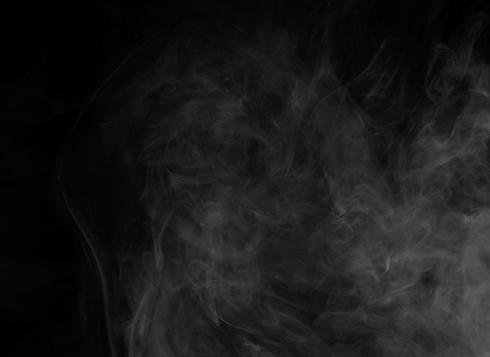 dynamic trend: Abstract smoke Weipa. Personal vaporizers fragrant steam. The concept of alternative non-nicotine smoking. White smoke on a black background. E-cigarette. Evaporator. Taking Close-up. Vaping. Stock Photo