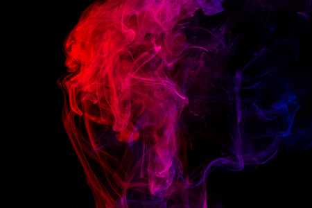 Abstract smoke Weipa. Personal vaporizers fragrant steam. The concept of alternative non-nicotine smoking. Purple pink smoke on a black background. E-cigarette. Evaporator. Taking Close-up. Vaping. Stock Photo