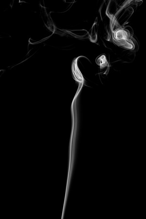 Abstract art. Gray smoke from the incense on a black background. Background for Halloween. Texture fog. Design element. The concept of aromatherapy. Stock Photo