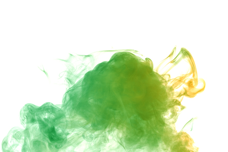 Abstract smoke Weipa. Personal vaporizers fragrant steam. The concept of alternative non-nicotine smoking. Green orange vape smoke on a white background. E-cigarette. Evaporator. Taking Close-up. Vaping.