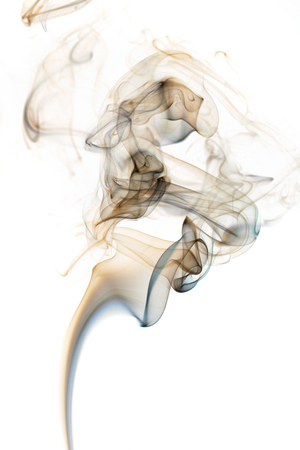 Abstract art. Brown smoke from the incense sticks on a white background. Background for Halloween. Texture fog. Design element. The concept of aromatherapy.