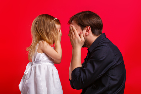 close your eyes: Father and daughter hid eyes. Emotional games with your child. Family fun. The joy of communication. I see nothing.